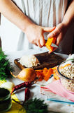 Vegetarians and cooking. Ladies hand cut green vegetable, ready Stock Image