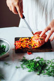 Vegetarians and cooking. Ladies hand cut green vegetable, ready Royalty Free Stock Image