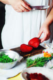 Vegetarians and cooking. Ladies hand cut green vegetable, ready Stock Photography