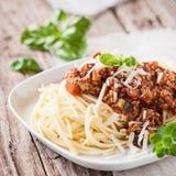 Vegetarien spaghetti bolognese. Bowl of vegetarien spaghetti bolognese with parmesan cheese and fresh basil Royalty Free Stock Image