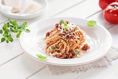 Vegetarien spaghetti bolognese. Bowl of vegetarien spaghetti bolognese with parmesan cheese and fresh basil Stock Image
