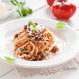 Vegetarien spaghetti bolognese. Bowl of vegetarien spaghetti bolognese with parmesan cheese and fresh basil Royalty Free Stock Photos