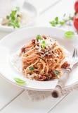Vegetarien spaghetti bolognese. Bowl of vegetarien spaghetti bolognese with parmesan cheese and fresh basil Royalty Free Stock Photo