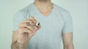 Vegetarier, Vegan in German Writing on Glass stock video