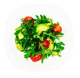 Vegetarischer Salat des Vitamins vom Arugula und von der Avocado auf weißer Platte Lizenzfreies Stockbild