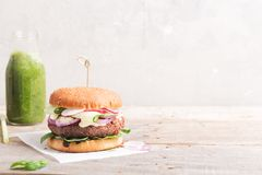 Veggie bean and quinoa burger with fresh vegetables. Copy space stock photography