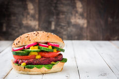 Veggie beet burgers on a white wooden table. Background Stock Photography
