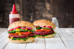 Veggie beet burgers on a white wooden table. Background Stock Photos