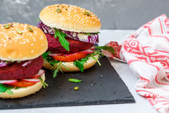 Veggie beet and lentil burgers with vegetables. Royalty Free Stock Photos