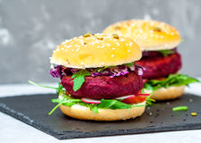 Veggie beet and lentil burgers with vegetables. Royalty Free Stock Image