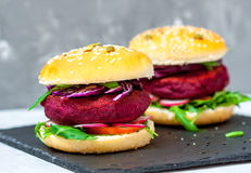 Veggie beet and lentil burgers with vegetables. Royalty Free Stock Photo