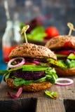 Veggie beet and quinoa burger stock photos