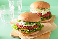 Veggie beet and quinoa burger with avocado dressing Royalty Free Stock Photos