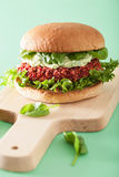 Veggie beet and quinoa burger with avocado dressing Royalty Free Stock Photography