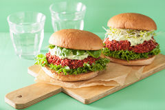 Veggie beet and quinoa burger with avocado dressing Royalty Free Stock Photo