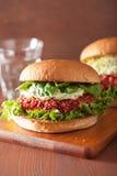 Veggie beet and quinoa burger with avocado dressing Stock Image
