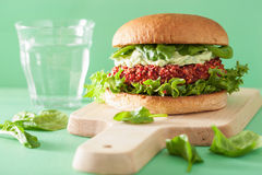 Veggie beet and quinoa burger with avocado dressing Stock Images