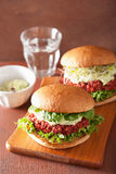 Veggie beet and quinoa burger with avocado dressing Royalty Free Stock Photo