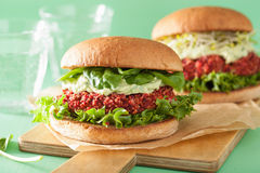 Veggie beet and quinoa burger with avocado dressing Royalty Free Stock Image
