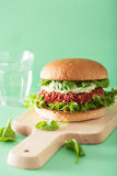 Veggie beet and quinoa burger with avocado dressing Royalty Free Stock Images