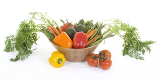Veggie Bowl 1. A bowl of fresh vegetables sits in a bamboo bowl on a white background royalty free stock images