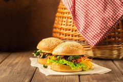 Veggie burger made fresh vegetable greens against dark wooden rustic background. The concept vegetable healthy food. royalty free stock photography