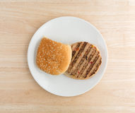 Veggie burger on a plate atop a wood table Stock Image