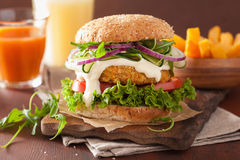 Veggie carrot and oats burger with cucumber onion Stock Photos