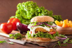 Veggie carrot and oats burger with cucumber onion Royalty Free Stock Photo