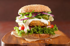 Veggie carrot and oats burger with cucumber onion Stock Images