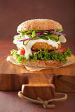 Veggie carrot and oats burger with cucumber onion tomato Stock Image