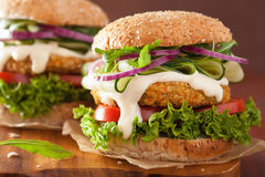 Veggie carrot and oats burger with cucumber onion tomato Royalty Free Stock Images