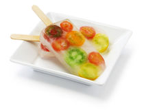 Veggie ice pop, colorful tomatoes Stock Images