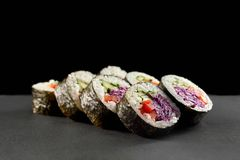 Vegetarian maki filled with vegetables. Veggie maki with white rice, cucumber, red paprika and violet cabbage. Sushi menu for vegetarians. Fresh rolls filled stock photos