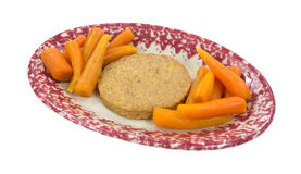 Veggie patty with carrots on oval dish Royalty Free Stock Image