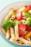 Veggie penne pasta with broccoli tomato carrot Stock Image
