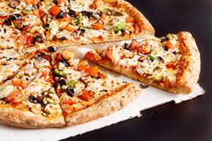 Veggie Pizza. Closeup of Veggie Pizza Sliced royalty free stock photography