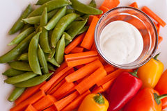 Veggie platter with dip. Bright and colorful veggie platter with Ranch dip Stock Photo