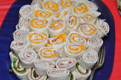 Veggie rolls with ham. Veggie rolls as appetizer with American cheese and ham Royalty Free Stock Photography