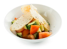 Veggie salad with toasts in plate Stock Images