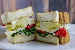 A Veggie Sandwich with Marinaded Red Peppers, Spinach and Artichoke stock images