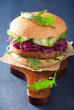 Veggie soy burger with pickled red cabbage cucumber arugula Stock Photos