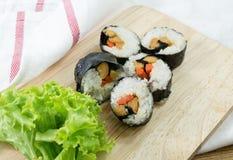 Veggie Sushi Rolls or Vegetable Maki on Wood Tray Stock Photo