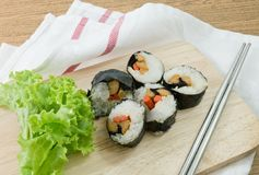 Veggie Sushi Rolls or Vegetable Maki on Wooden Board Royalty Free Stock Photography