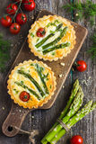 Veggie tart with asparagus and cherry tomatoes Royalty Free Stock Photo
