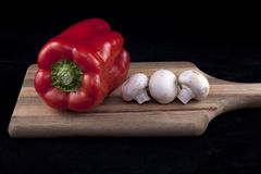 Veggies displayed on cutting board. Royalty Free Stock Image
