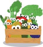 Veggies engraçados em uma caixa de madeira Imagem de Stock