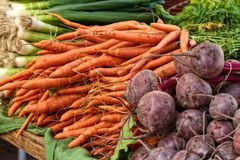 Veggies at the farmer's market. Carrots, beets, and onions at the farmer's market Stock Photos