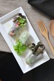 Veggies Rolls on White Plate Stock Photo