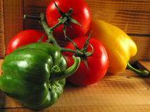 Veggies rustical. Still of paprika and tomatoes in rustical atmosphere Stock Photo